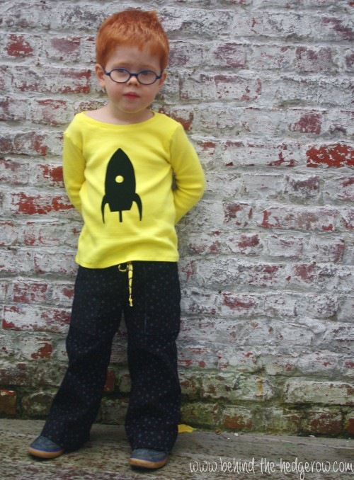 Sandbox trousers and flocking tee - leaning against wall