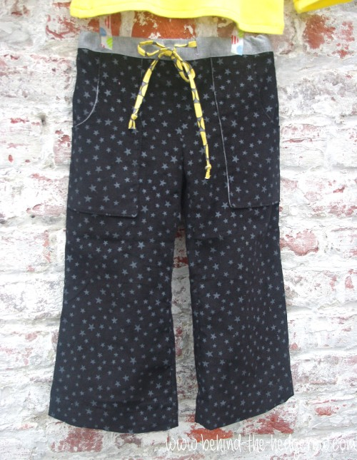 Sandbox trousers and flocking tee - trousers on wall