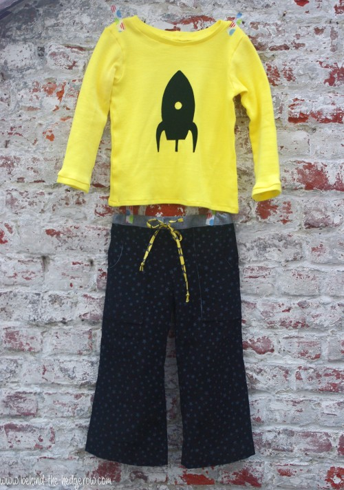Sandbox Trousers and flocking tee - whole outfit on wall